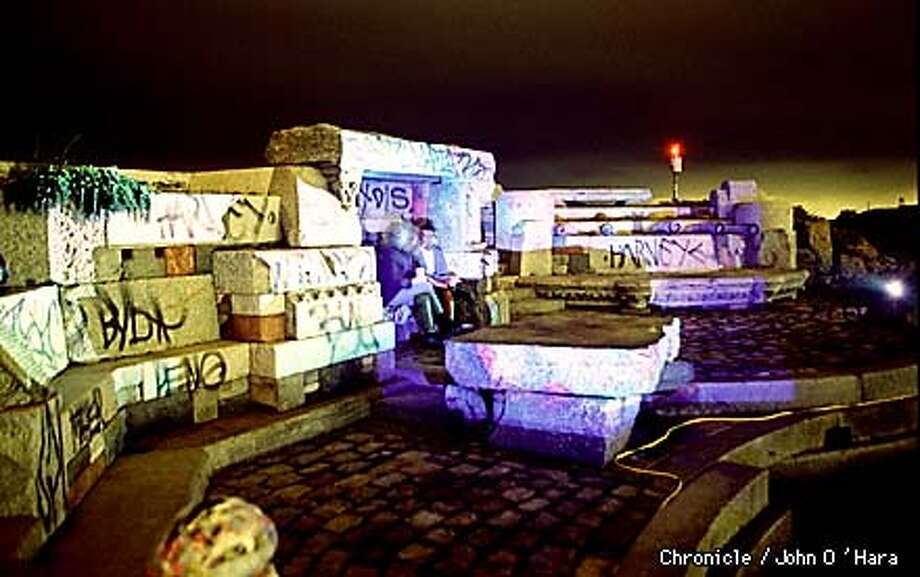 "San Francisco, The jetty at St. Francis Yaught Club. ""Matt Godfrey"" acid light show on the granite blocks made into a pedesrtian grotto, Graffitti takes away from the total art form of light at the end of the jettey. BY JOHN O'HARA/THE CHRONICLE"