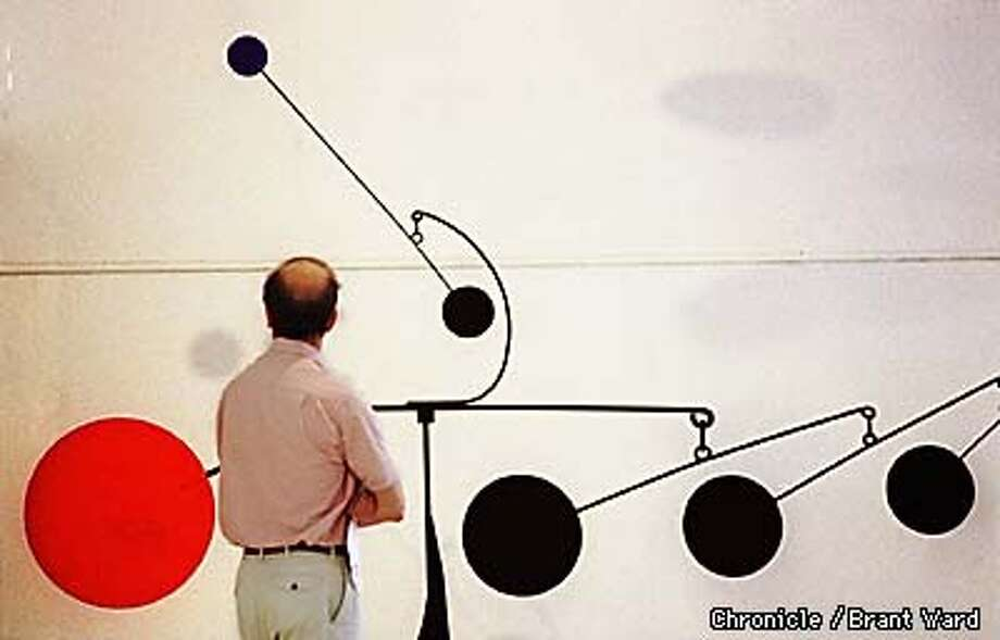 A man studies a Calder mobil at the SFMOMA Monday morning. BY BRANT WARD/THE CHRONICLE Photo: BRANT WARD