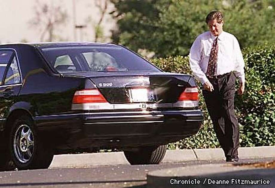 Insurance agent Russell Pierce leaves his Fremont office and is getting into his Mercedes. BY DEANNE FITZMAURICE/THE CHRONICLE
