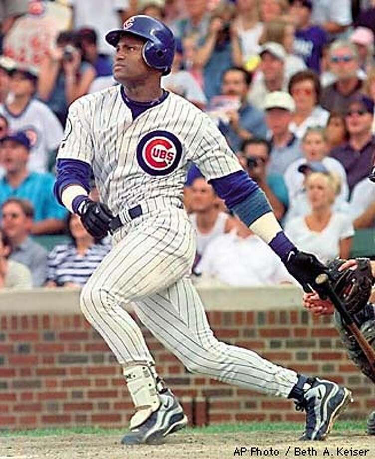 Chicago Cubs rightfielder Sammy Sosa watches his 62nd home run of the season sail over the wall in the bottom of the ninth inning against the Milwaukee Brewers in Chicago, Sunday, Sept 13, 1998. (AP Photo/Beth A. Keiser) Photo: BETH A. KEISER
