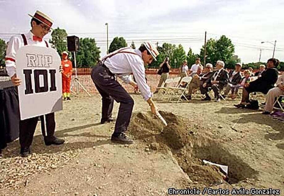 Steve Leitner, right, and Terrill Tanaka, left, bury the burdens of a Peninsula commute during the ground breaking ceremonies for the new Caltrain Station in Mountain View, on Wednesday, September 23, 1998. The burdens of the commute include parking tickets, car repair bills, broken car parts and other nightmares of the commute. (CHRONICLE PHOTO BY CARLOS AVILA GONZALEZ) Photo: CARLOS AVILA GONZALEZ