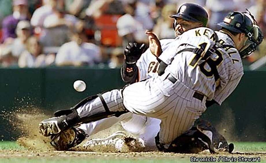 The SF Giants Barry Bonds slides safely into home plate after the Pittsburgh Pirates catcher Jason Kendall fails to get a grip on the ball. Bonds scored in the seventh innning on a sacrifice by Joe Carter. The Giants beat the Pirates 6-2 to keep their playoff hopes alive. BY CHRIS STEWART/THE CHRONICLE Photo: CHRIS STEWART