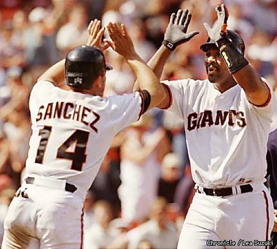 JOE CARTER GETS A HIGH FIVE FROM REY SANCHEZ AFTER HITTING A HOME RUN IN THE BOTTOM OF THE SIXTH TO BRING THE GIANTS AHEAD 3 TO 1. CARTER BROUGHT IN SANCHEZ AND KENT WITH THE HOME RUN. PHOTO BY LEA SUZUKI Photo: LEA SUZUKI