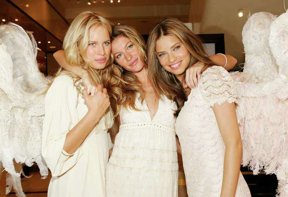 """Victoria's Secret Angels:Gisele Bundchen and Adriana Lima, among others, were the stars of a memorable 2002 Victoria's Secret ad entitled """"What is Sexy?"""". Watch it here. Photo: Evan Agostini, Getty Images / 2006 Getty Images"""