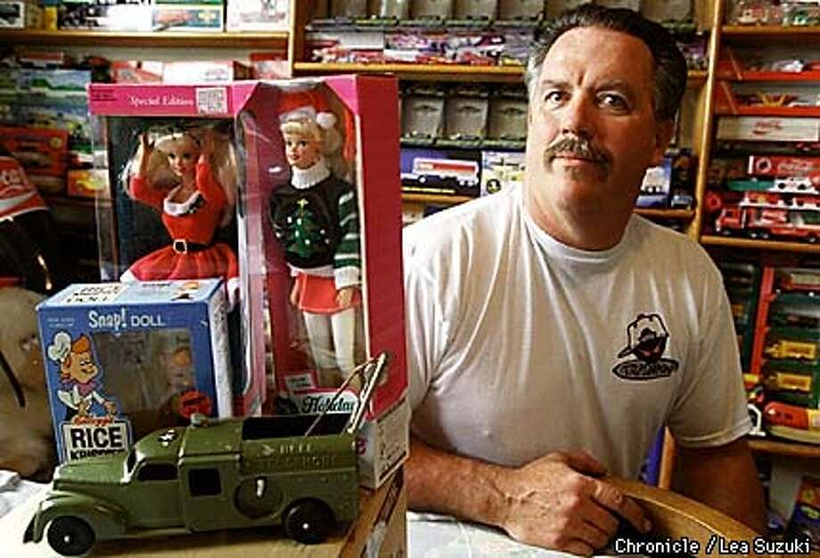 Greg Bailey, collector, with a few collectibles he purchsed on Ebay. Clockwise from upper left: 1992 Barbie Holiday Hostess, 1996 Barbie Holiday Seasons, a PG & E truck from the 1940's, and a Kellog's give away Snap doll. Photo By Lea Suzuki Photo: LEA SUZUKI