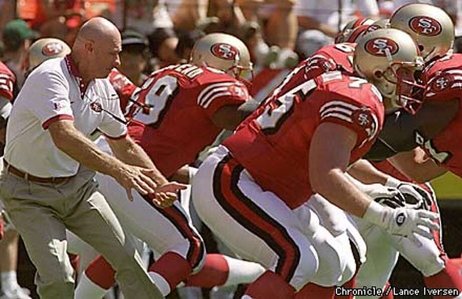 49ERS-MCKITTRICK/C/8AUG96/SP/LI  Offensive line coach stands in the QB possition as his players go through their practice drills prior tio the Rams game last sunday. By Lance Iversen/San Francisco Chronicle Photo: LANCE IVERSEN