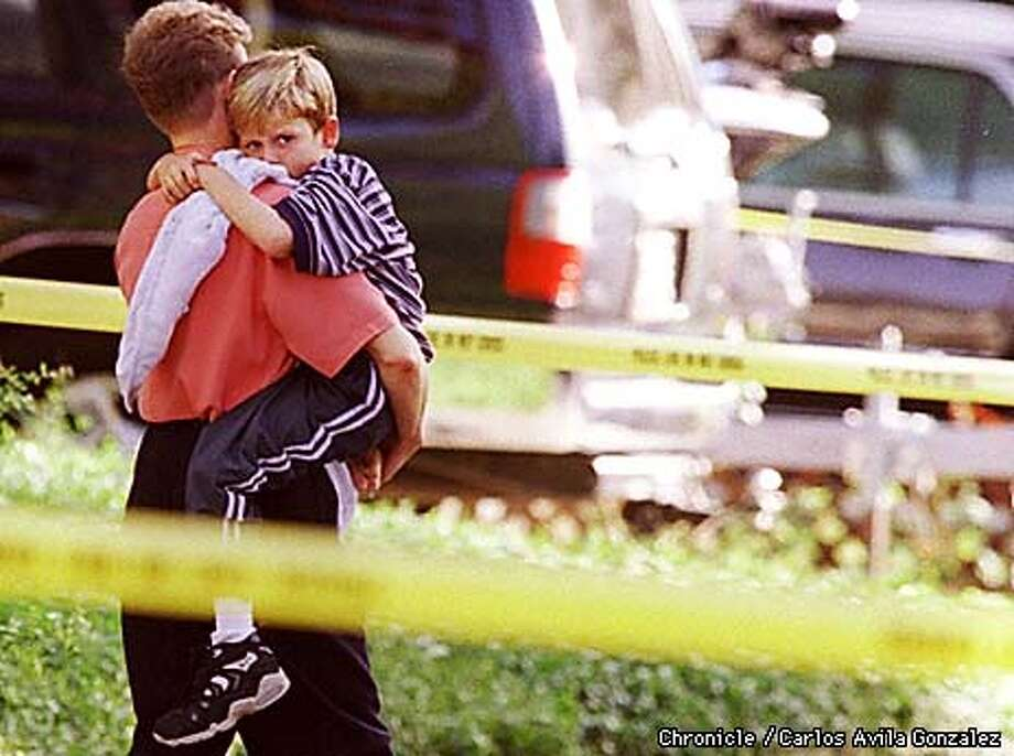 RESIDERNTS OF FERNE AVE. believed to be neighbors of the victims in Palo Alto, leave home after three bodies were discovered at 418 Fern Ave. bodies found monday afternoon sept 22, 1998  Photo by........Carlos Avila Gonzalez