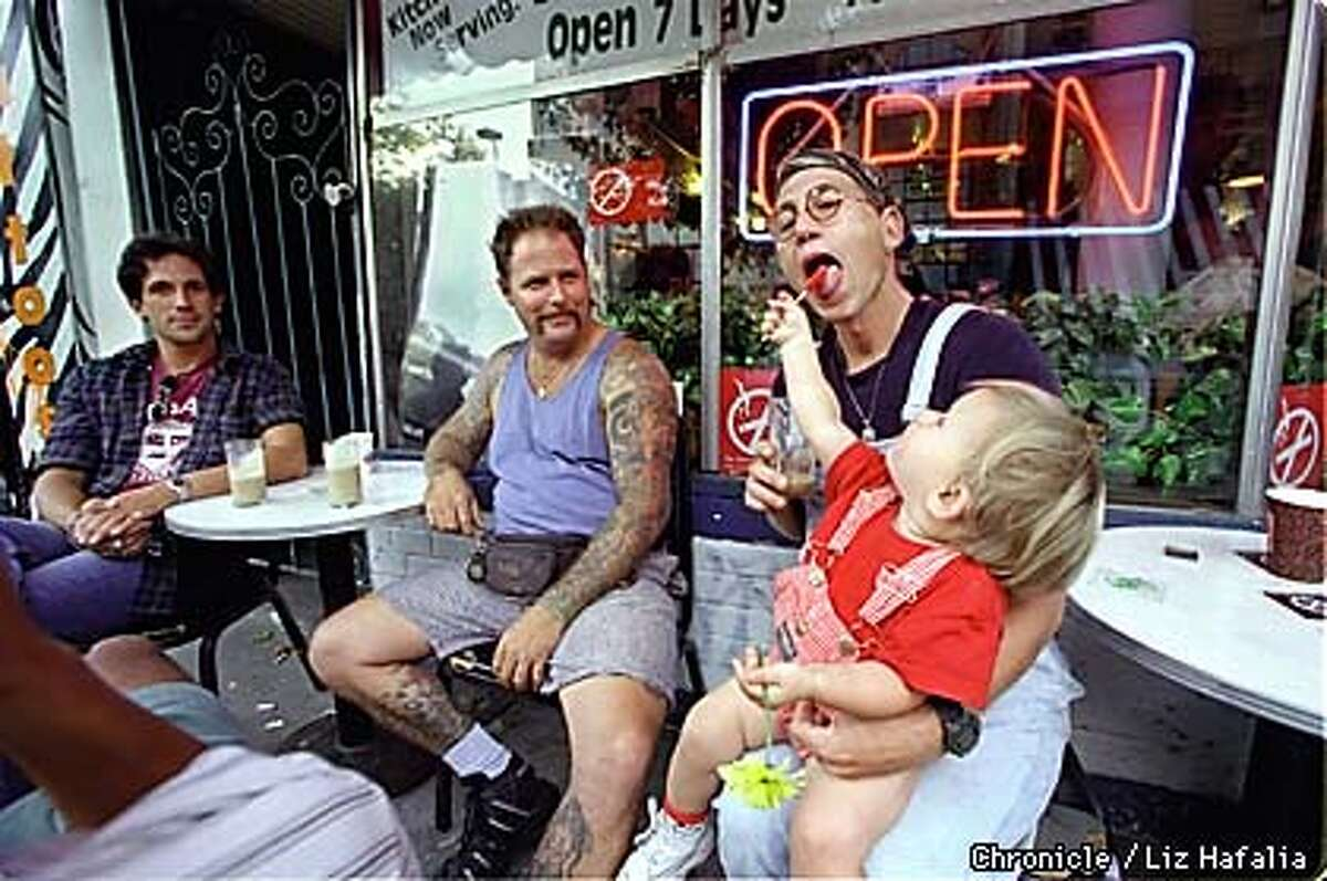 Cafe Mediterraneum--2475 Telegraph. (left to right)--Todd Tilden, David Hassall, Al (no last name) and his 18 month old daughter Angelica. These guys get together to socialize after work hours. Tilden says cellulars are not allowed at this table. Photo by Liz Hafalia