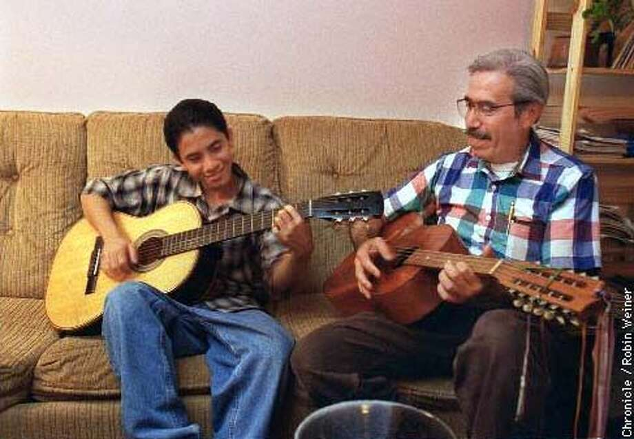 Jose Jaime Garcia and his son Esteban, 14, made music in their  Corte Madera home. Chronicle photo by Robin Weiner