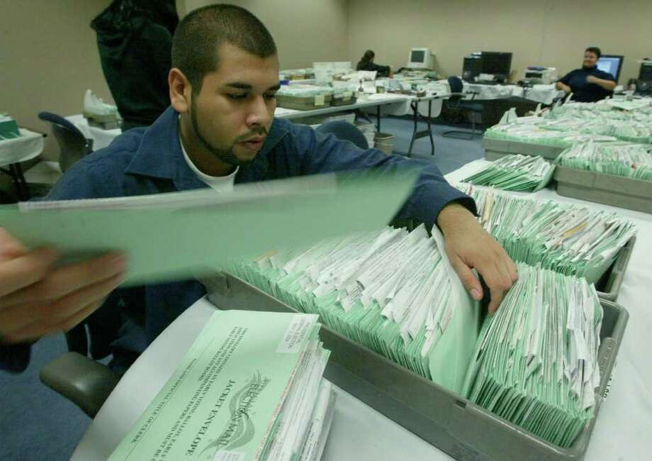Texas and other states have made it easier for military personnel serving abroad to obtain absentee ballots in a timely manner. Photo: Associated Press / EL PASO TIMES