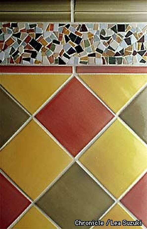 Tile pattern with mosaic border. Clique Monaco Dado Rail, Clique Monaco Half Round, Clique Monaco Clean Edge Fld., Confetti Border Random Color. Photo By Lea Suzuki Photo: LEA SUZUKI