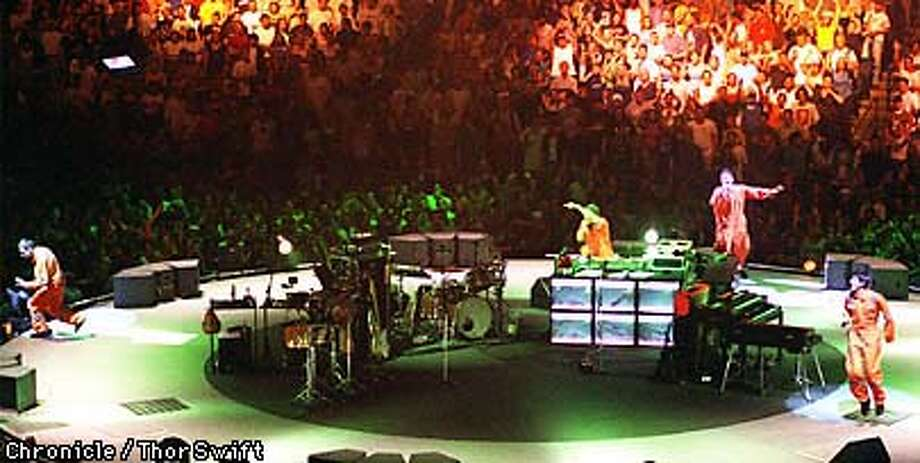 The Beastie Boys (left to right) Adam Yauch, DJ Mis Master Mike, Adam Horovitz and Michael Diamond perform in the round at The New Arena in Oakland Sunday Sep. 13, 1998.  BY THOR SWIFT/THE CHRONICLE Photo: THOR SWIFT