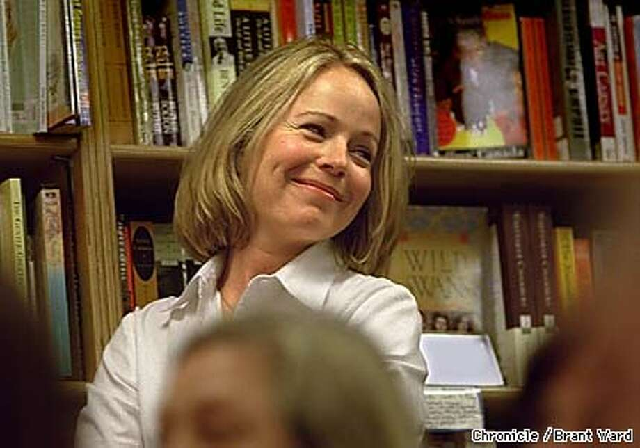 """ORTHODOX1/01SEP98/DD/BW--Author Dani Shapiro smiled as she listened to a comment from the crowd at a Clean Well-Lighted Place for books in San Francisco before reading from her memoir """"Slow Motion."""" By Brant Ward/Chronicle"""