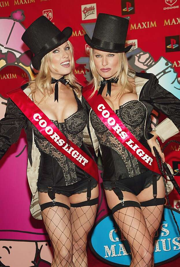 HOUSTON - JANUARY 30:  (L-R)  Diane and Elaine Klimaszewski, a.k.a the Coors Light twins, attend the Maxim Magazine's Circus Maximus Party at the Regal Ranch in Houston, Texas, January 30, 2004.  (Photo by Evan Agostini/Getty Images) Photo: Evan Agostini
