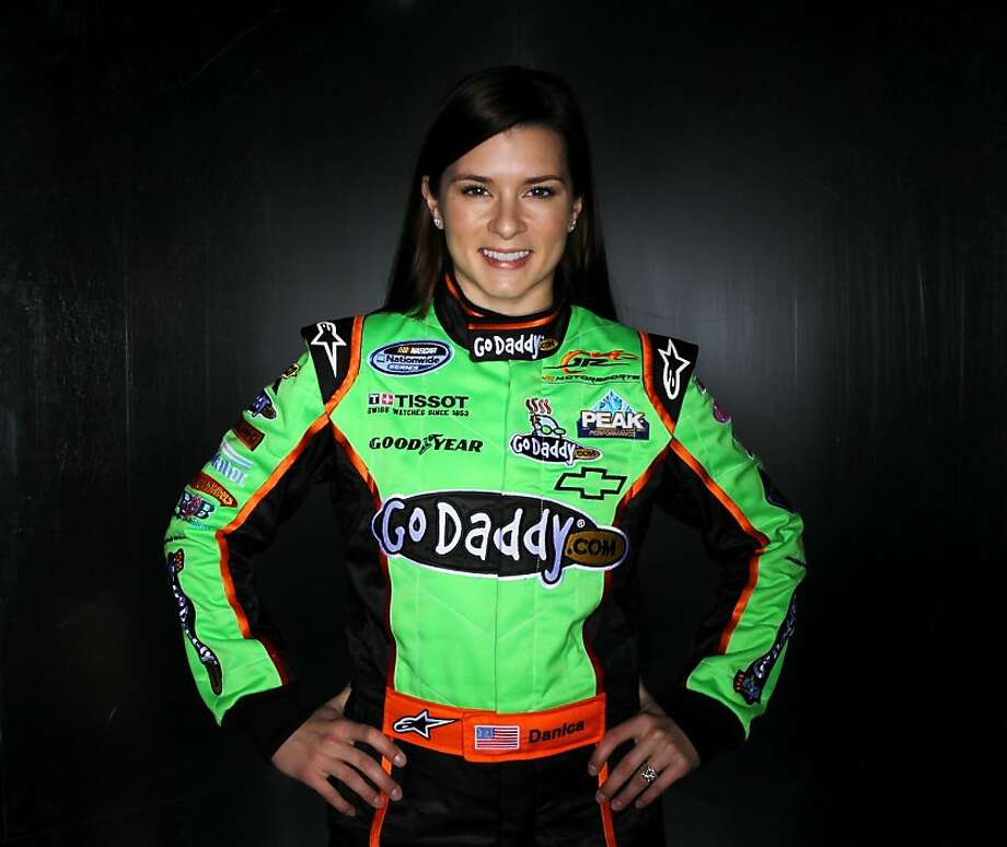 DAYTONA BEACH, FL - FEBRUARY 10:  Danica Patrick, driver of the #7 GoDaddy.com Chevrolet, poses during the 2011 NASCAR Nationwide Series Media Day at Daytona International Speedway on February 10, 2011 in Daytona Beach, Florida.  (Photo by Nick Laham/Getty Images for NASCAR) Photo: Nick Laham, Getty Images For NASCAR