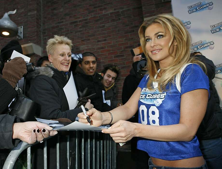 In this photo released by The Hershey Company, Carmen Electra greets fans outside Hershey's Times Square store, Thursday, Jan. 31, 2008, in New York.  Electra offered a sneak peek of her new Ice Breakers Ice Cubes commercial which will debut Feb. 3 during the Superbowl. (AP Photo/The Hershey Company, Diane Bondareff) ** NO SALES ** Photo: Diane Bondareff