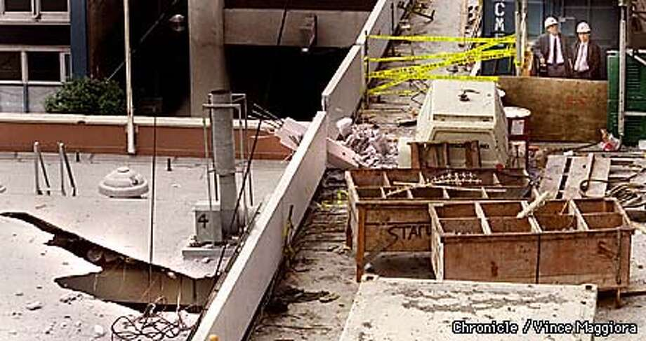 = The hole in thje roof of Station No.1 the fire station at Howard & 3rd where a 8 by 10 9 ton concrete slab crashed through the roof also some damage to the hotel under construction . by Vince Maggiora Photo: VINCE MAGGIORA