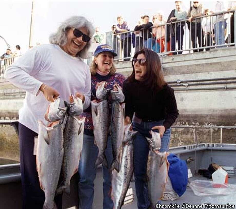 "SALMON/C/02MAR96/MN/DF - The women on the ""Butchie B"" fishing boat were very successful on opening day of salmon fishing. Onlookers at fisherman's wharf look at the catch. (l to r) Linda Fry, Susan Gabriel, and Palmira Brandt. Chronicle photo by Deanne fitzmaurice Photo: DEANNE FITZMAURICE"