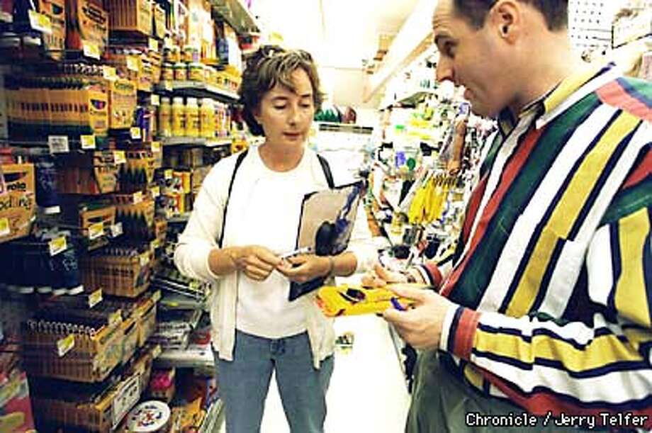 Diane Rapley gets help with purchases from Jeff Leopold, co-owner of Standard 5 & 10 stores in Laurel Village.  BY JERRY TELFER/THE CHRONICLE Photo: JERRY TELFER