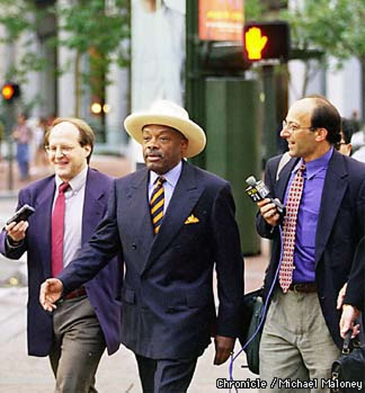 Mayor Willie Brown flanked by Edward Epstein and KCBS reporter Mike Sugarman walks against a red light. The Chronicle and KCBS challenged the mayor who walked and Muni to a race between Hyde Street and Montgomery Street. Muni won by 10 minutes. BY MICHAEL MALONEY/THE CHRONICLE