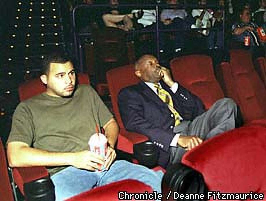 """Mayor Willie Brown attends movies on the weekends. He is sitting with an aide watching """"Saving Private Ryan"""" at the new AMC movie complex.  BY DEANNE FITZMAURICE/THE CHRONICLE Photo: DEANNE FITZMAURICE"""