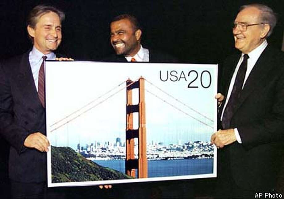 """Streets of San Francisco"" stars Karl Malden, right, and Michael Douglas, left, are reunited Sunday June 1, 1997, in San Francisco, with Executive Director of the Postal Stamp Service, Azeez Jaffer, to unveil artist renditions of the new 20-cent postcard depicting the Golden Gate Bridge. The 20-cent card, along with a 50-cent version, will be available for sale nationwide on June 2, 1997. (AP Photo/U.S. Postal Service, ho)"