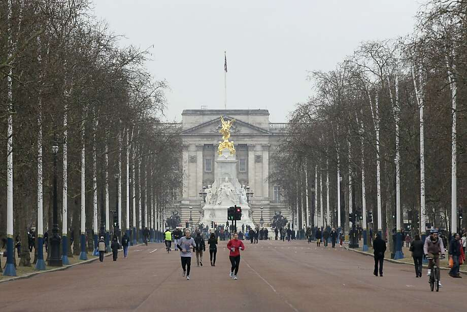 In this Sunday, Jan. 29, 2012 photo, people jog down the Mall from Buckingham Palace in London. The Mall will host the start and finish of London 2012 Olympic marathon, race walk and road cycling competitions with most sections of the courses free to watch. (AP Photo/Sang Tan) Photo: Sang Tan, Associated Press