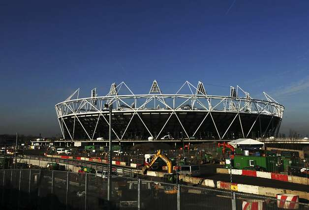The sun shining on the main Olympic stadium  in London. Photo: Matt Dunham, Associated Press