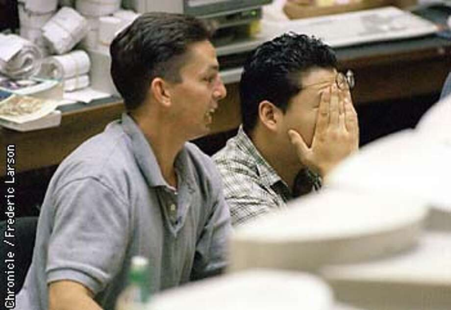 : Stock traders from the Pacific Stock exchange react to the 512 point drop in the stock market during the closing minute of trading. Chronicle photo by Frederic Larson. Photo: Frederic Larson