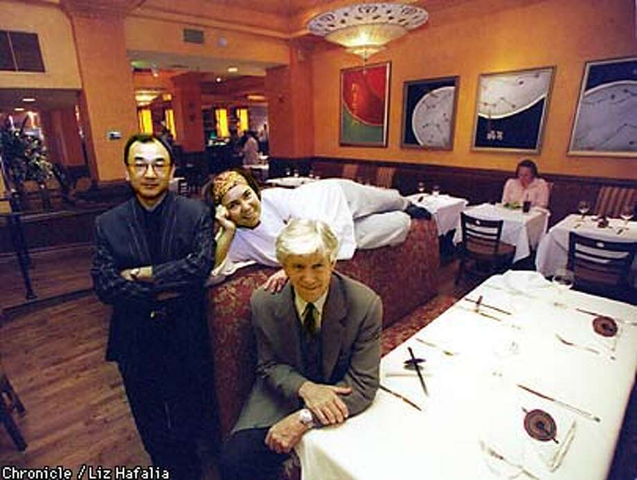 Owners Nori Yoshida (standing) and Robert Puccini (seated) with head chef Brenda Buenviaje at Oritalia restaurant . Photo by Liz Hafalia Photo: LIZ HAFALIA