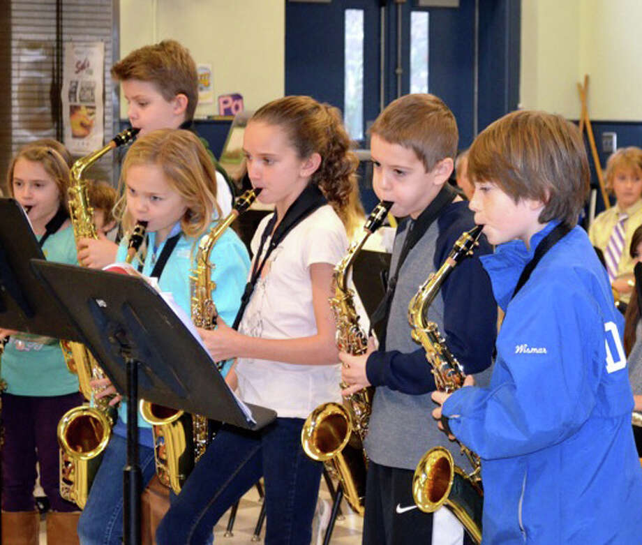 Playing their saxophones, from left, are Olivia Montanaro, Nolan Lovegrove, Isabelle Smith, Isabel Infurna, Lennan McEniry and Truman Wismar. Photo: Contributed Photo
