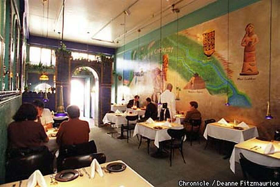 YaYa Restaurant has large painted murals and archways repeated in the interior. CHRONICLE PHOTO BY DEANNE FITZMAURICE Photo: DEANNE FITZMAURICE
