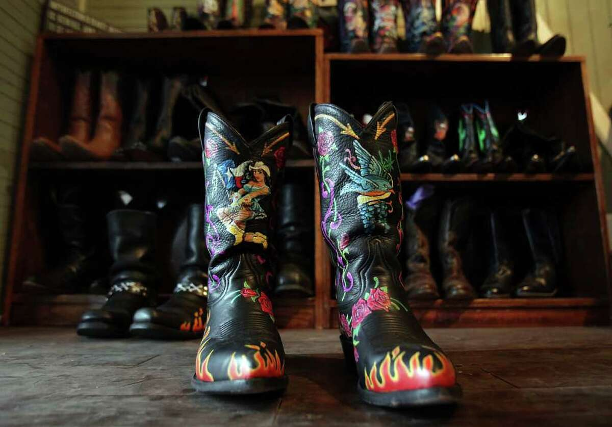 Many of Kathleen Kridler's hand painted cowboy boots carry images familiar from tattoos, such as flames and flowers.