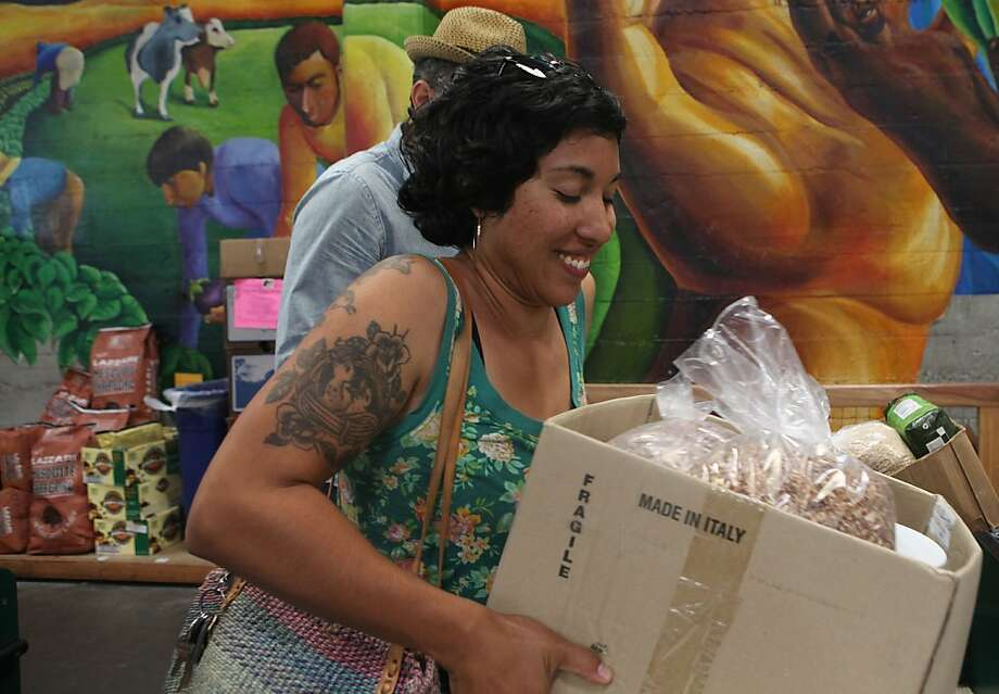 Francine Madrid carrying her bulk items at checkout in Rainbow Grocery Cooperative in San Francisco, California, on Monday, September 19, 2011. Photo: Liz Hafalia, The Chronicle 2011