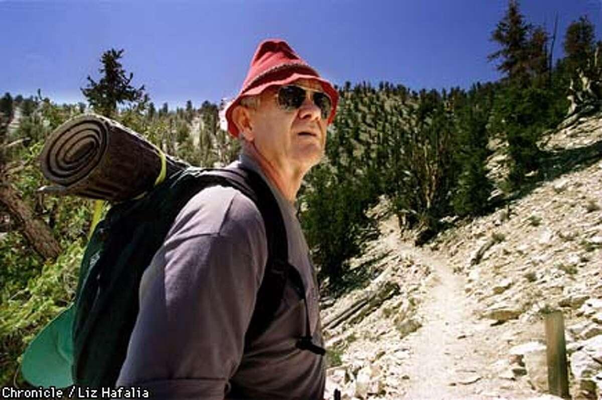 METHUSALAH2/C/11AUG98/SC--Death Valley historian and retired forest service geneticist LeRoy Johnson walking in Methusalah Grove near Bishop. Photo by Liz Hafalia