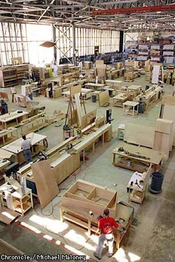The woodshop area takes up one third of the warehouse of Delphi Productions.  Delphi Productions at Hangar 39, Alameda Point is a company that designs, creates and stores exhibits for high tech trade shows. They recently moved from Oakland to a converted warehouse formerly used as a Navy helicopter repair facility.  Photo by Michael Maloney Photo: MICHAEL MALONEY