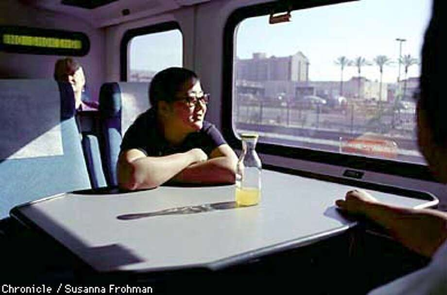 BARTRAIL01/C/08AUG98/MN/SLF --- Capitol Corridor commuter Kim Natsuko, waits with her friend Sang-Ku Kim, for the Sacramento-bound train to leave the Emeryville Amtrak Station. BART has recently taken over operations of the Capitol Corridor trains, giving riders hope that service will increase from Sacramento and Alameda County to the South Bay. (CHRONICLE PHOTO BY SUSANNA FROHMAN) Photo: SUSANNA FROHMAN