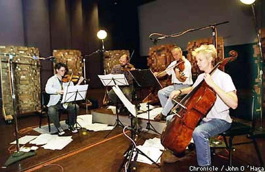 "Skywalker Ranch, Marin County.  Kronos Quartet, recording a Phillip Glass score for the reissue of the classic Bela Legosi film, ""Dracula"".  l to r, David Harrington, JKohn Sherba, Hank Dutt, Joan Heanrenaud.  BY JOHN O'HARA/THE CHRONICLE Photo: JOHN O'HARA"