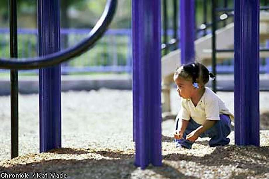 With teachers near-by, Two-year-old Kiela Moseby plays alone in the sand in the playground at theArroyo Vista Child development Center in Dublin Friday morning. SAN FRANCISCO CHRONICLE PHOT BY KAT WADE Photo: KAT WADE