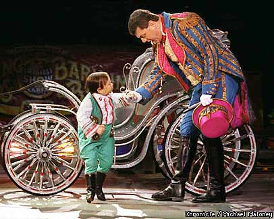 """""""Michu"""" the world's smallest man at 33 inches gets a helping hand off the carriage by Ringmaster Jim Ragona.  One of the side show performers of Ringling Bros. and Barnum & Bailey circus performing at the New Arena in Oakland.  BY MICHAEL MALONEY/THE CHRONICLE Photo: MICHAEL MALONEY"""