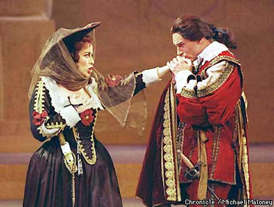 Don Giovanni (Mel Ulrich) kisses the hand of Donna Elvira (Cynthia Clayton) in the Walnut Creek based Festival Opera's Don Giovanni.  Photo by Michael Maloney Photo: MICHAEL MALONEY