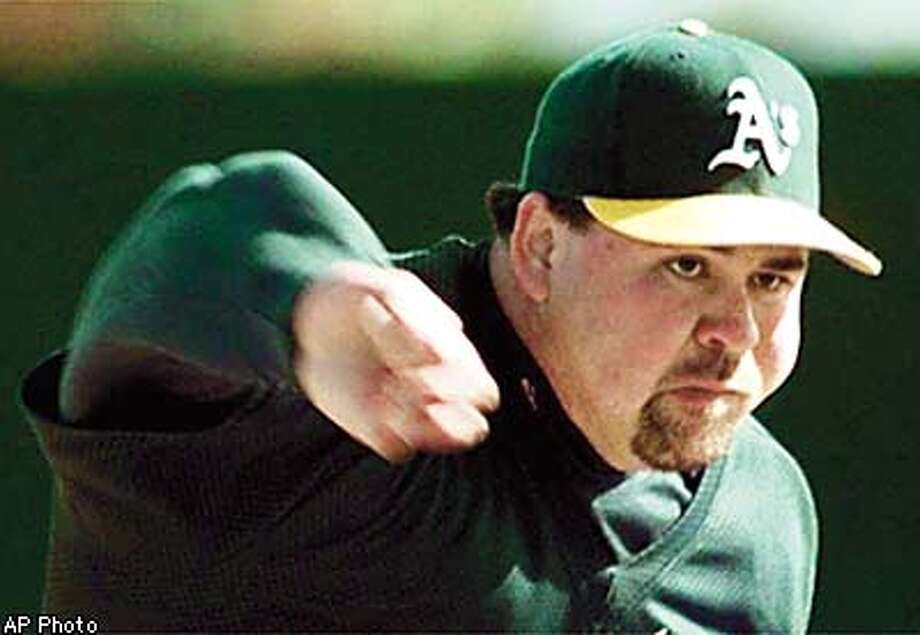 Newly-acquired Oakland Athletics relief pitcher makes his first throws during the Athletics first day of spring training in Phoenix, Ariz., Sunday Feb. 15, 1998. Fetters, who pitched last season for the Milwaukee Brewers, is battling for the A's closer spot with Billy Taylor.(AP Photo/Eric Risberg) Photo: ERIC RISBERG