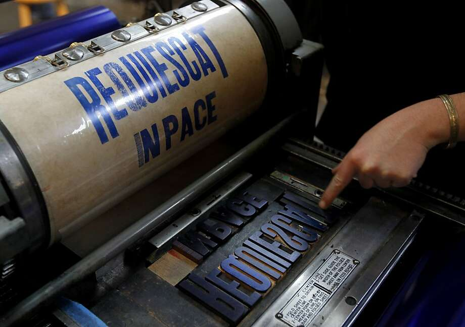 Students print a proof of the Latin phrase for Rest in Peace during a letterpress printing class project in San Francisco, Calif. on Saturday, Jan. 14, 2012. Photo: Paul Chinn, The Chronicle