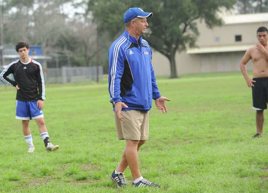 Coach Brian Arendale works with the Kelly High School soccer team during practice on Wednesday.  Photo taken Wedensday, February 1, 2012 Guiseppe Barranco/The Enterprise Photo: Guiseppe Barranco, STAFF PHOTOGRAPHER / The Beaumont Enterprise