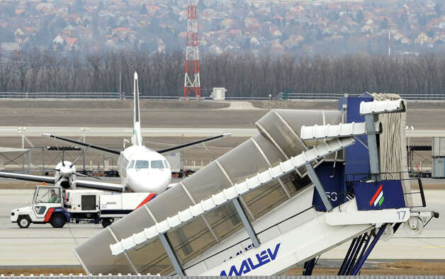 Adding to the recent carnage, Hungarian Airline Malev grounded its fleet on Friday, Feb. 3, 2012. The debt-ridden airline collapsed after nervous suppliers began asking for advance payments, which the Malev was unable to provide, and creditors blocked two of its aircraft from taking off from Dublin and Tel Aviv, The (U.K.) Guardian reported. Other airlines are trying to help thousands of stranded passengers. Photo: ATTILA KISBENEDEK/AFP/Getty Images