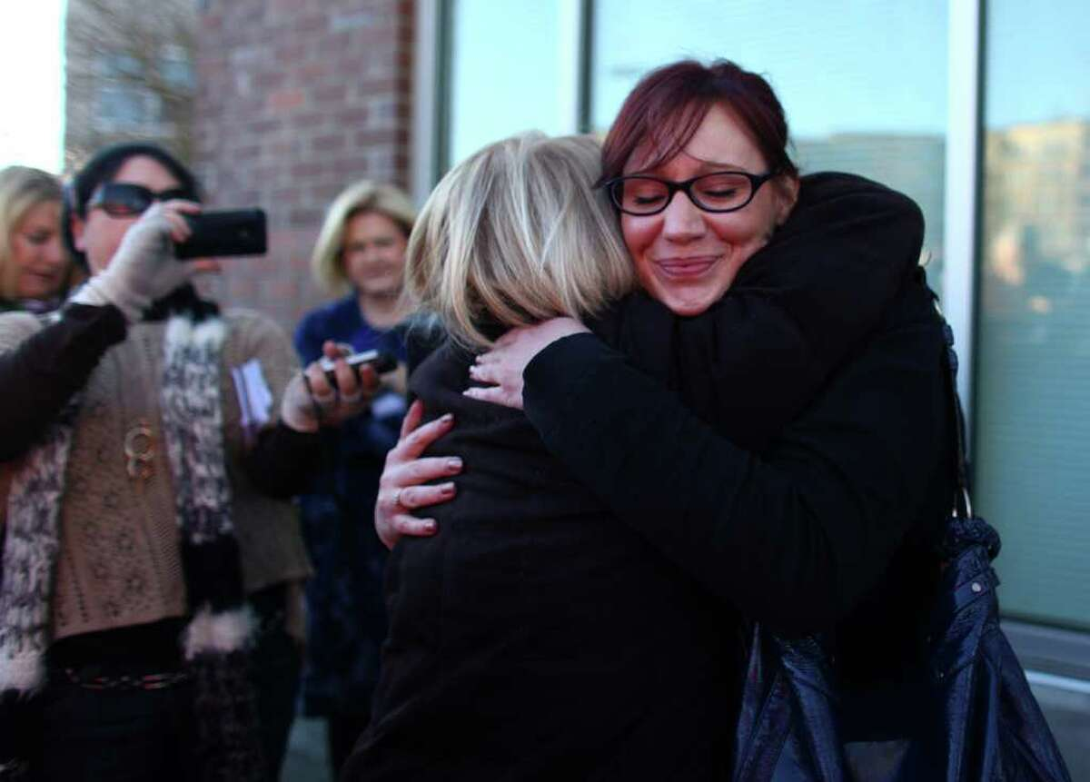 Planned Parenthood supporter Sharona Lindgren hugs U.S. Senator Patty Murray in front of the not-for-profit family planning agency on Friday, February 3, 2012 on East Madison Street in Seattle. Lindgren, a full-time student and mother of 2, used the organization's services which discovered a lump in her breast. She said she has had multiple family members with breast cancer. Dozens of supporters of the organization gathered with U.S. Senator Patty Murray after the Susan G. Komen for the Cure foundation reversed a decision to suspend funding to Planned Parenthood.