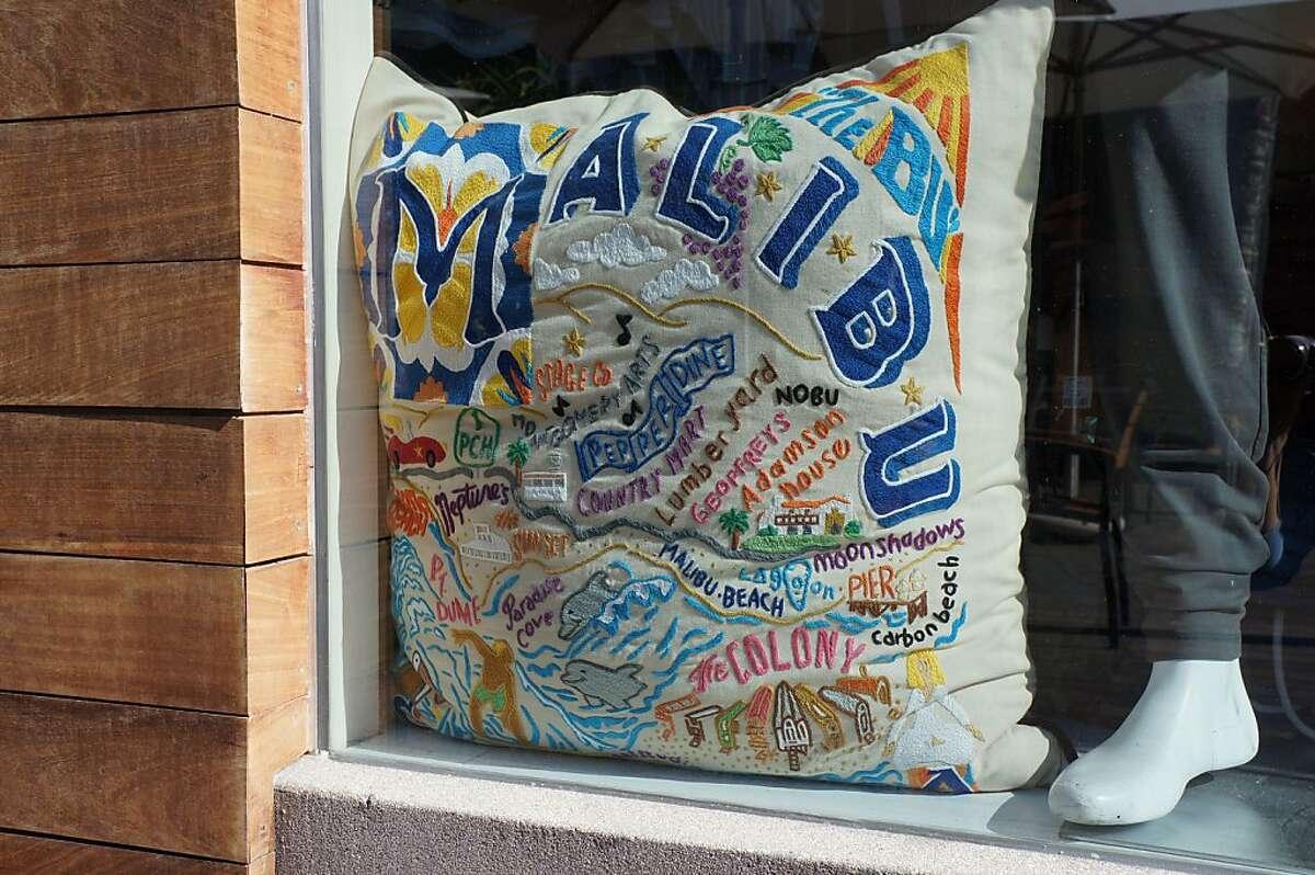 Scenes from Malibu, Calif.: El Matador Beach; a pillow in the window of the Malibu Country Mart; the Adamson House