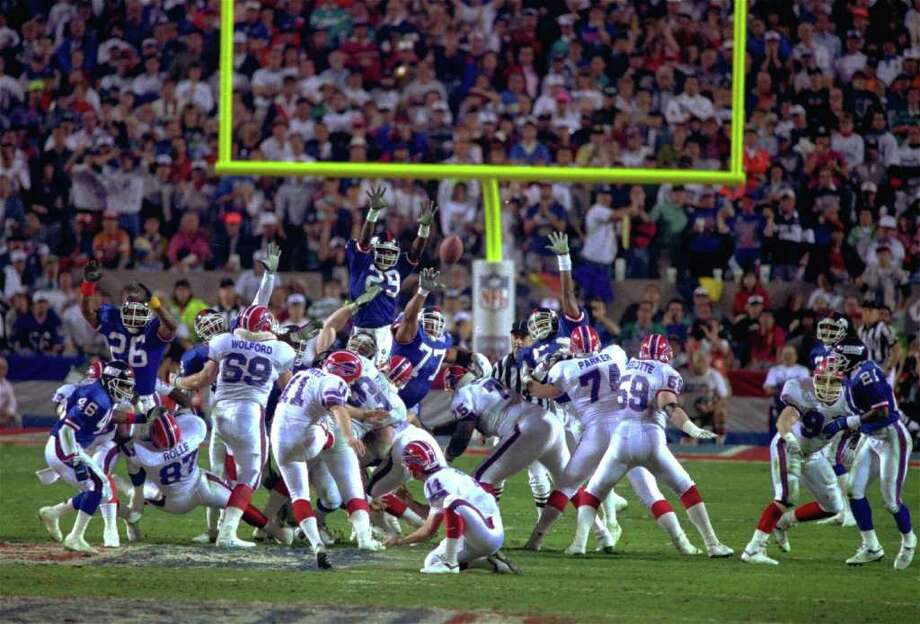 9. Super Bowl XXV New York Giants 20, Buffalo 19: The Bills' four-year run of futility began with a game they would have won, despite being largely throttled by the Giants' ball-control offense, if Scott Norwood hadn't been wide right on  a 47-yard field goal at the end. Photo: PHIL SANDLIN, AP / 1991 AP