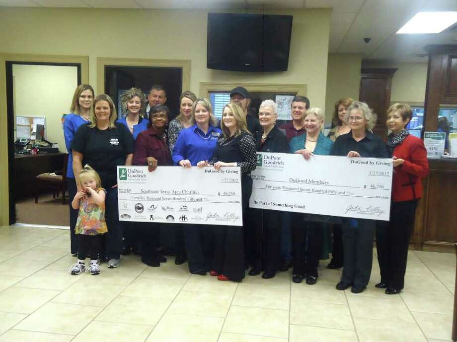 Representatives for five charities along with the Jasper Lake Sam Rayburn Chamber of Commerce gathered to receive $7500 in donations from Dupont Goodrich Federal Credit Union. The charities are the Rainbow Room, Jasper Share, SNIPS, the Jasper Lakes Area Humane Society, and Lakes Area Hospice. Photo: Jodie Warner