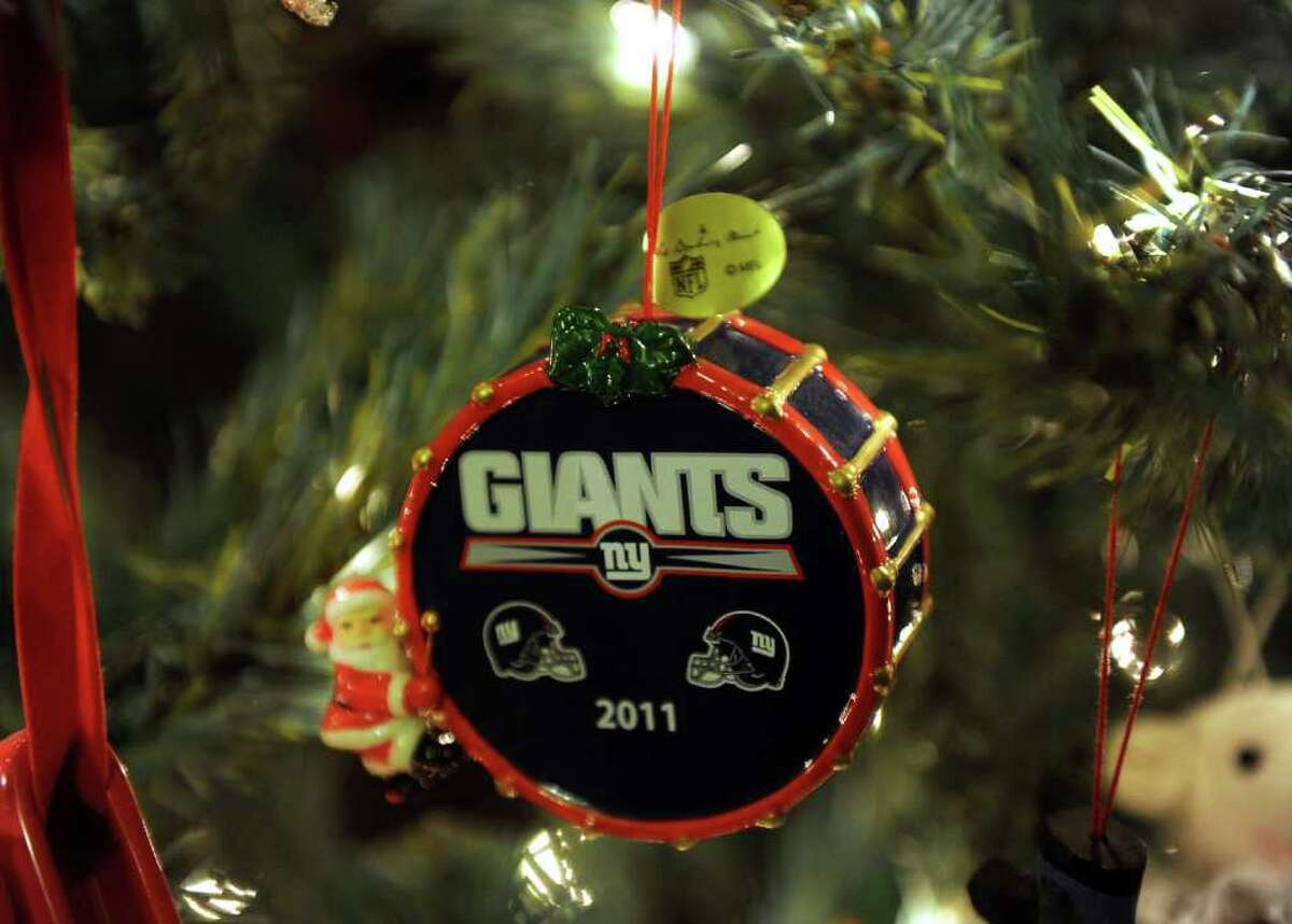 """One of a bunch of Giants ornaments decorating fan Lynn Ramos' Christmas tree at her home in Bridgeport, Conn. on Wednesday February 1, 2012. She and her son Bobby decided to leave the tree up because it was """"good luck"""" for the team. They won't take it down until after the superbowl."""